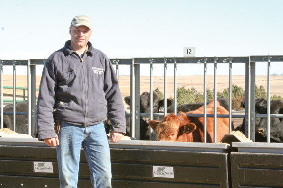 Vaughn Thorstenson shows the GrowSafe feed system that helps him monitor any significant drop of feed intake for his herd.