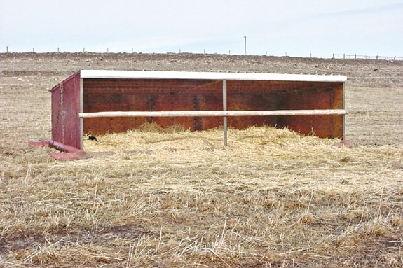 A portable calving shelter built on skids.