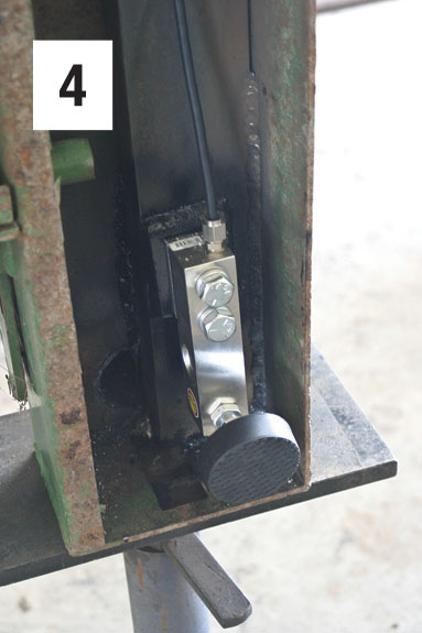 A load sensor attached to the bottom of a squeeze chute