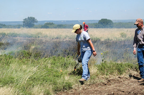 Prescribed fires are normally started with a dip torch