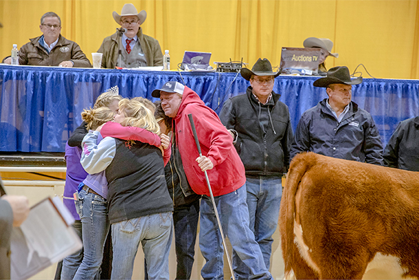 hug at cattle auction