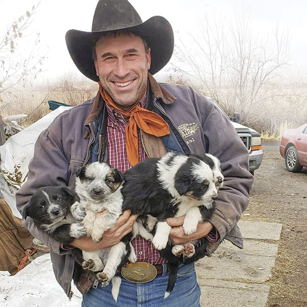 Paul Marchant and his puppies
