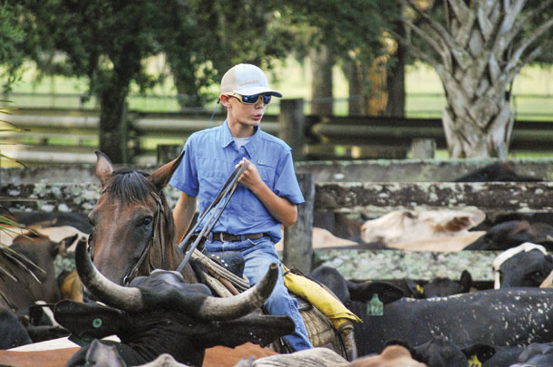 Wade (Happy) Kempfer, sixth generation, works cattle on horseback